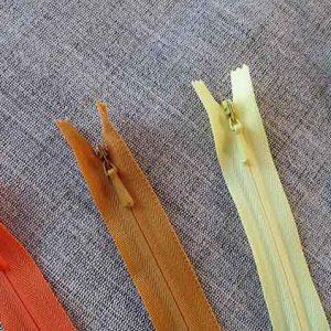 YKK concealed/invisible zips: cream/yellow/orange