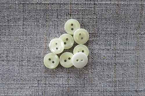 Two-hole, pearlised 11mm buttons, cream