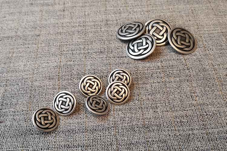 Silver metal buttons with Celtic knot design
