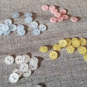Polyester star buttons (11mm)